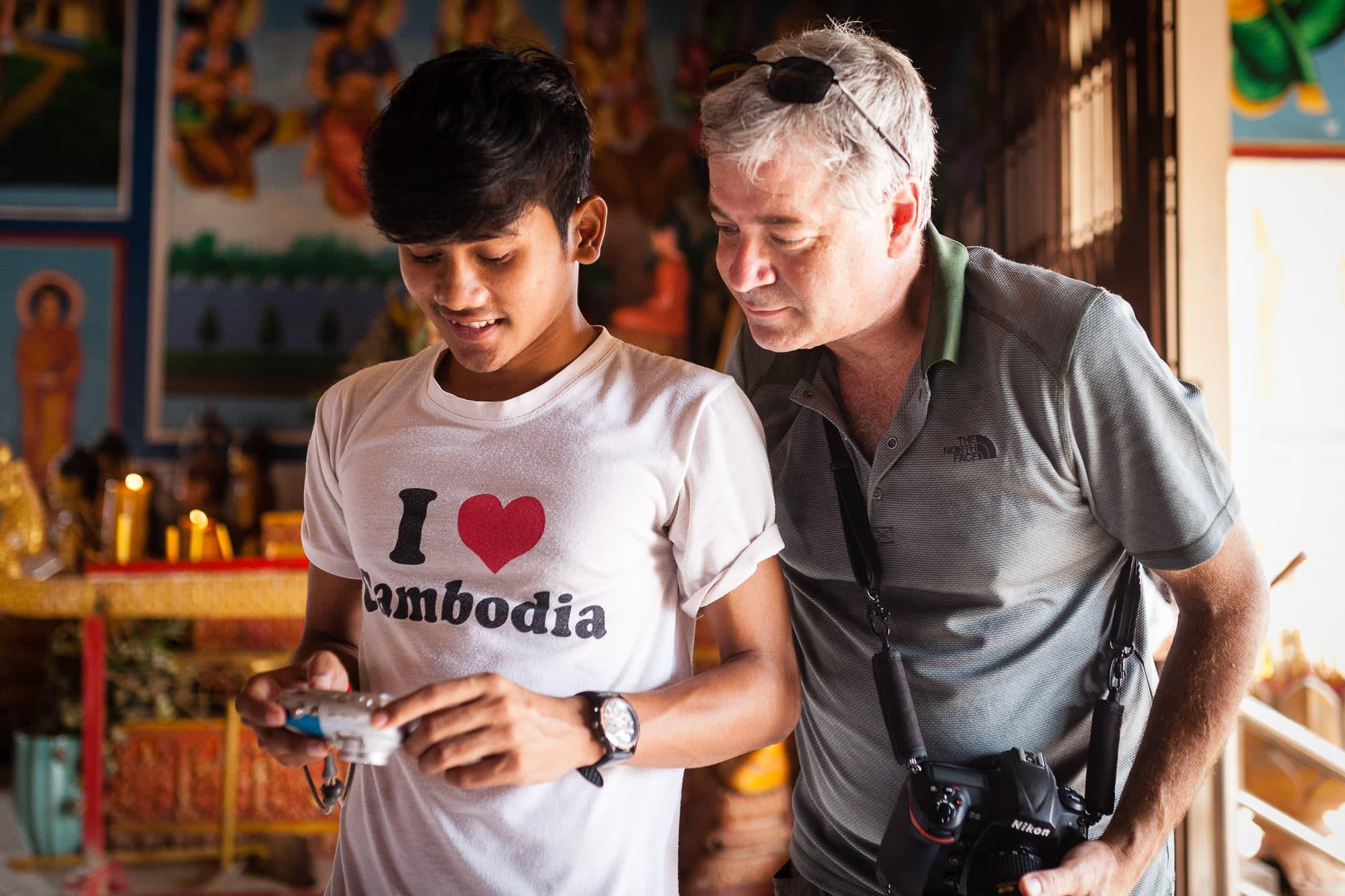 Jeff Dannay working with Anjali student photographer. Photo by Regis Binard.