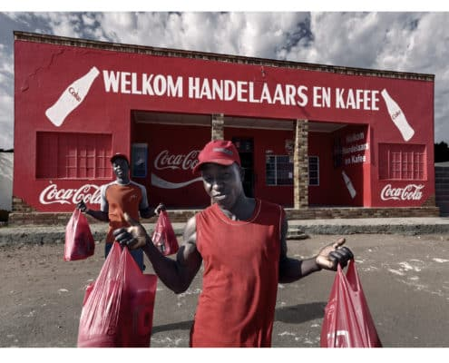 Zimbabwean refugees, now employed in South Africa, buy groceries for the weekend at a trading store near Lutzville in South Africa's West Coast.